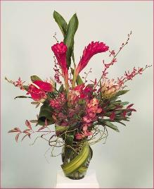 ginger and orchids tall floral arrangement: Bold celebration!