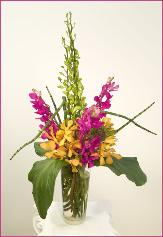 assorted orchids bouquet in glass vase
